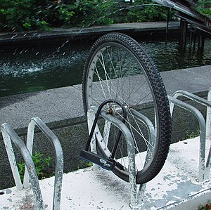 Bicycle lock - Front wheel is locked with U-lock, but the rest of the bicycle is gone.