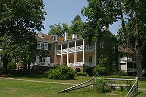 Clemuel Ricketts Mansion - The rear of the house with the two-story porch on the inside of the L; the wing added in 1913 is at far right.