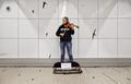 Street musician in Brussels Central Station (DSCF7054).png