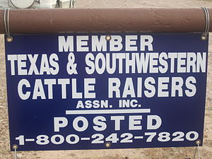 Texas and Southwestern Cattle Raisers Association - The standard Texas and Southwestern Cattle Raisers Association identification sign; photo taken near the ranch of Gene S. Walker, Sr., in Webb County, Texas.