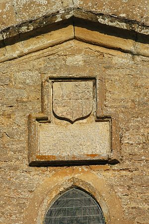Tackley - St Nicholas' parish church: 17th-century date stone under the chancel gable