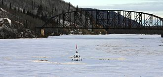 Nenana Ice Classic - The Tanana River with the tripod on the ice during the 2008 Nenana Ice Classic.  The Mears Memorial Bridge is in the background.