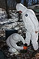 Taping rubber boots to the outer Tyveck suit (5429943802).jpg