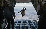 Tech. Sgt. Benjamin Jonas jumps out of a C-130 Hercules while flying over Yokota Air Base (25405079031).jpg
