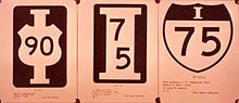 Three black and white submissions, the third being similar to the modern Interstate Highway shield