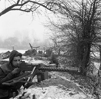 22nd Armoured Brigade (United Kingdom) - A soldier from the 1st Battalion, Rifle Brigade, 7th Armoured Division, manning a M1919 Browning machine gun, 31 December 1944.