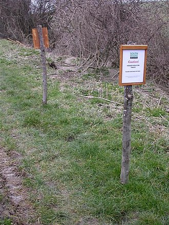 """Nanny state - The signs say """"Caution! Hidden hole on track"""" and have been erected by the South Downs Park authority—a careful look shows there is a brown mark midway between the posts which is the hole and some argue this to be unnecessary."""