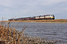 Train running next to a river