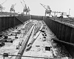 The keel plate of USS United States (CVA-58) being laid in a construction dry dock on 18 April 1948.jpg