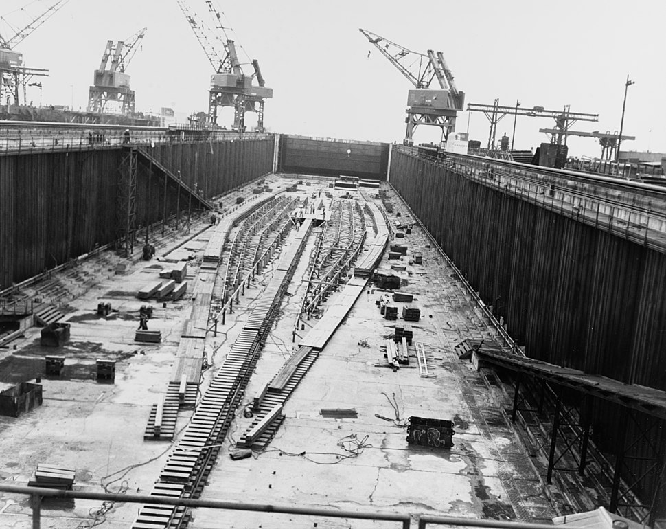 The keel plate of USS United States (CVA-58) being laid in a construction dry dock on 18 April 1948