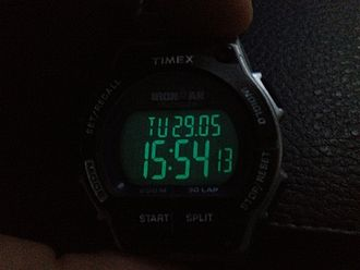 Indiglo - Indiglo feature on a Timex Ironman digital watch with a negative display