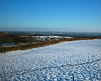 Totley - Totley Moor looking towards Sheffield in winter 2005. The moors are a barren wasteland with little vegetation but heather and trees near brooks and streams.