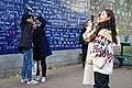 Tourists at the Wall of Love.jpg