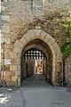 Town gate with machicolations in Villeneuve 01.jpg