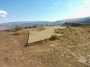 Airway beacon - Remnants of Transcontinental Air Mail Route Beacon 37A, atop a bluff in St. George, Utah, with concrete arrow indicating the direction to the next beacon