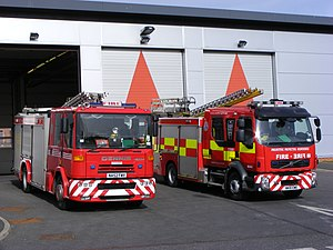 Tyne and Wear Fire and Rescue Service - A 2002 Dennis Sabre fire appliance (left) in traditional Tyne and Wear livery and a 2010 Volvo FL appliance (right) with new battenburg markings, pictured on the forecourt of Sunderland Central fire station in North Moor.