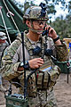 U.S. Air Force Capt. Johnny Koyama, a joint terminal attack controller with the 3rd Air Support Operations Squadron, performs a radio check while providing close air support for Soldiers with the 4th Infantry 130723-A-ZX807-002.jpg