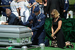 U.S. Air Force Col. Gary Henderson, commander of the 23rd Wing, second from right, his wife, Erin, and Capt. Kyle Deem, a pilot with the 41st Rescue Squadron, pay their respects to Capt. David A. Wisniewski 100823-F-JI436-010.jpg