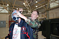 U.S. Air Force Senior Airman Shea, right, fits employer Terry Eisenman with a gas mask during the Bosses Day event for the 914th Airlift Wing and the 107th Airlift Wing, New York Air National Guard at Niagara 080808-F-YR431-015.jpg