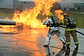 U.S. Air Force firefighters suppress fires during a training exercise on a concrete pad known as a burn pad at Spangdahlem Air Base, Germany, Jan. 8, 2014 140108-F-OP138-152.jpg