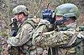 U.S. Air Force joint terminal attack controller, foreground, views information transmitted over a radio during exercise Combined Resolve Nov. 17, 2013, at the Joint Multinational Readiness Center in Hohenfels 131117-A-EM978-010.jpg