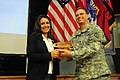 U.S. Army Lt. Col. Todd Johnson, the commander of Headquarters and Headquarters Battalion, 25th Infantry Division, presents a token of appreciation to Congresswoman Tulsi Gabbard, left, the representative for 130327-A-ZU340-050.jpg