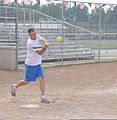 U.S. Coast Guard Lt. Cmdr. Jason Biggar, the chief of the planning department at Coast Guard Civil Engineering Unit Cleveland, swings at a pitch during his unit's softball practice July 31, 2013, at Kennedy 130731-G-KB946-069.jpg