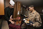 U.S. Marines and Sailors with the 26th MEU and USS Kearsarge share a Christmas meal 151222-M-PA636-089.jpg