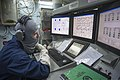 U.S. Navy Chief Gas Turbine Systems Technician (Electrical) Tommy Cunningham monitors the engineering systems from the central control station aboard the guided missile destroyer USS Stout (DDG 55) during 140103-N-UD469-276.jpg