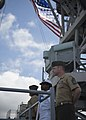 U.S. Sailors and Marines man the rails aboard the amphibious dock landing ship USS Pearl Harbor (LSD 52) May 25, 2013, as the ship leaves Pearl Harbor, Hawaii, for Samoa, the first mission port for Pacific 130525-N-SP369-077.jpg
