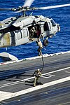 U.S. Sailors assigned to Explosive Ordnance Disposal Mobile Unit (EODMU) 5 conduct fast-rope exercises from an MH-60S Seahawk helicopter assigned to Helicopter Sea Combat Squadron (HSC) 12 onto the flight deck 130820-N-ZS026-428.jpg