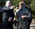U.S. Sen. John McCain of Arizona, left, speaks with Latvian Land Forces Lt. Col. Gunars Kaulins, the director of exercise Summer Shield, during a live-fire exercise conducted by U.S., Latvian and Estonian 140415-M-FD819-077.jpg