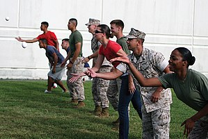 Egg tossing - U.S. Marines and sailors participate in an egg-toss competition at the Commissary Commando competition held at the Camp Foster commissary