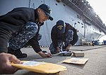 USS Bonhomme Richard (LHD 6) Mail Call 170103-N-TH560-010.jpg
