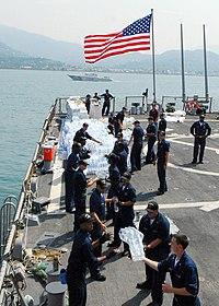 USS McFaul (DDG 74) sailors unload humanitarian supplies