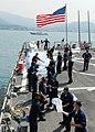 USS McFaul (DDG 74) sailors unload humanitarian supplies.jpg
