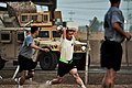 US Army 52942 CAMP TAJI, Iraq-Maj. Marcus Gengler (center), from Ontario, Calif., commander, Company B, 615th Aviation Support Battalion, takes a throw in during a scrimmage game, Oct 10. Gengler and his team were.jpg