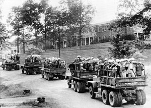Ole Miss riot of 1962 - US Army trucks loaded with steel-helmeted US Marshals roll across the University of Mississippi campus on October 3, 1962.