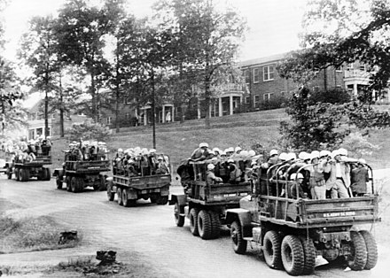 U.S. Army trucks loaded with U.S. Marshals on the University of Mississippi campus US Marshals at Ole Miss October 1962 cph.3c35522.jpg