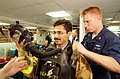 US Navy 020924-N-4309A-030 Damage Controlman assists with the firefighting gear of Pakistani Lieutenant from the Pakistani ship Tippu Sultan (DDG 185).jpg