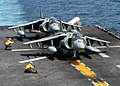 US Navy 040411-N-6380E-284 AV-8B Harriers get permission for take-off from the flight deck of the amphibious assault ship USS Wasp (LHD 1).jpg