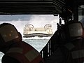 US Navy 040522-N-5663H-037 Sailors aboard the amphibious dock landing ship USS Fort McHenry (LSD 43) keep a watchful eye as a Landing Craft Air Cushioned (LCAC) approaches the ship's well deck.jpg