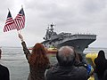 US Navy 040527-N-3925A-001 Friends and family members of Sailors and Marines aboard the amphibious assault ship USS Belleau Wood (LHA 3) wave goodbye from the pier.jpg