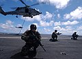 US Navy 040721-N-4308O-188 Explosive Ordnance Disposal Mobile Unit Six (EOD MU-6) Detachment 10 performs a fast rope exercise on the flight deck aboard Nimitz class aircraft carrier USS Harry S. Truman (CVN 75).jpg