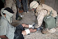 US Navy 041113-M-2789C-001 Hospital Corpsman Lucas Jushinski of Seattle, Wash., assigned to Company B, 1st Battalion 8th Marine Regiment, Regimental Combat Team 7, administers aid to a wounded detainee in Fallujah, Iraq.jpg