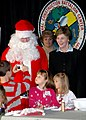 US Navy 051212-N-0553R-003 A U.S. Navy Seabee dependent takes a picture of First Lady Laura Bush and Santa Claus, during a visit to Construction Battalion Center (CBC) in Gulfport.jpg