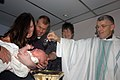 US Navy 060430-N-4702D-001 Commander 7th Fleet Chaplain, Capt. Bill Devine, performs the first documented baptism aboard the amphibious-command ship USS Blue Ridge (LCC 19).jpg
