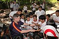 US Navy 061018-N-2970T-116 Boatswain's Mate 1st Class James McCune plays with the children of Gordon Heights II Elementary School, Olongapo City, Philippines.jpg