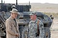 US Navy 070426-N-4928M-072 Navy Capt. Garry Mace, Commander, Joint Crew Composite Squadron 1 based in Baghdad, Iraq, talks to his son, Lance Cpl. Joshua Mace.jpg