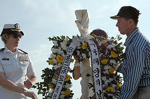 United States National Maritime Day - Image: US Navy 070518 N 0021M 002 Capt. Susan Dunlap, Commander of Military Sealift Command Far East and Capt. Robert Burk, Commanding officer of SS Major Stephen J. Pless receive a wreath that was part of the National Maritime Day Re
